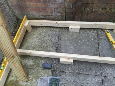feet on decking frame